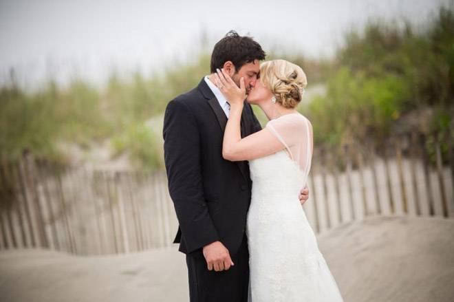 real_wedding_couple_kiss_on_the_beach__full